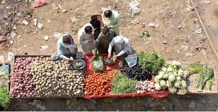 A vendor displaying the fresh vegetables to attract the customers at Rahmatpur