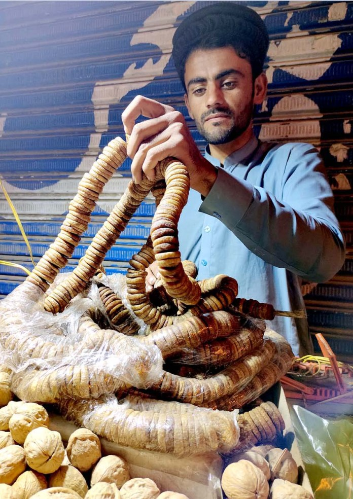 A vendor selling dry fruit at Pakistan Chowk