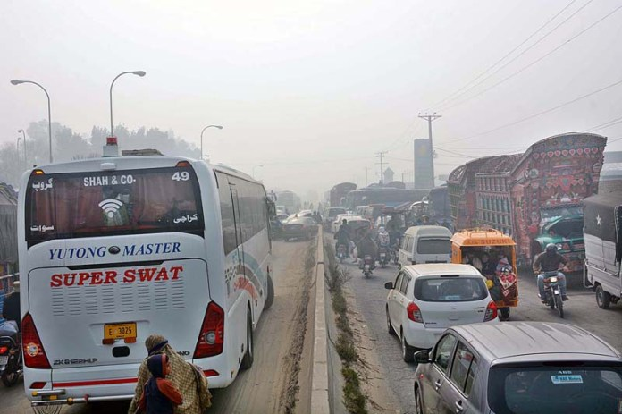 A view of traffic jam on Sargodha Road because Motorway Interchange closed due to heavy fog in city during morning time