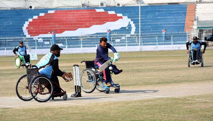Quetta Strikers and Lahore Sikandars special cricket team players in action during Pakistan Champion League organized by Pakistan Wheelchair Cricket Council in connection with Kashmir Solidarity Day at Iqbal Stadium