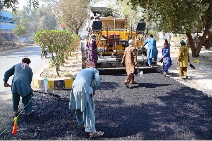 A view of construction work of a road during development work at Latifabad