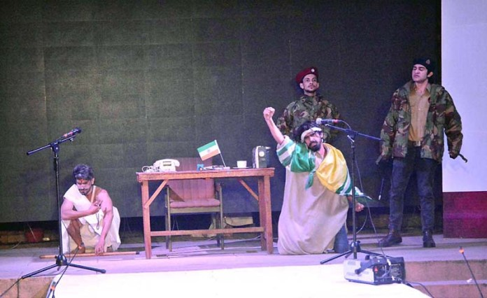 Students performing on the stage during Last day drama festival to make Kashmir day organized by arts council and University of Punjab at Al-Hamra