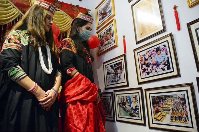 PESHAWAR: February 12 – Visitor viewing the displayed stuff during one-day festival at China Window in connection with New Chinese Year starts from February 12 arranged by Sports, Culture, Tourism and Youth Affair Department