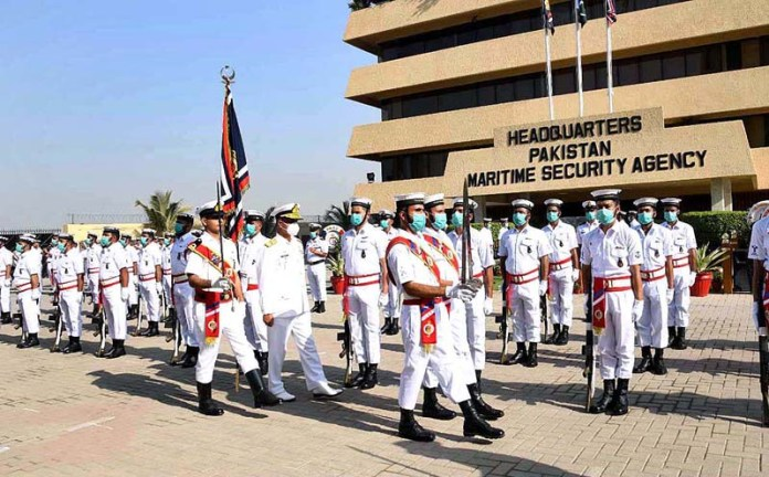 Chief of the Naval Staff Admiral Muhammad Amjad Khan Niazi reviewing the Guard of honor during visit to headquarters Pakistan Maritime Security Agency