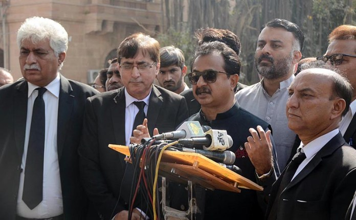 Leader of Opposition in Sindh Assembly and PTI leader Haleem Adil Sheikh talking to media outside the Sindh High Court