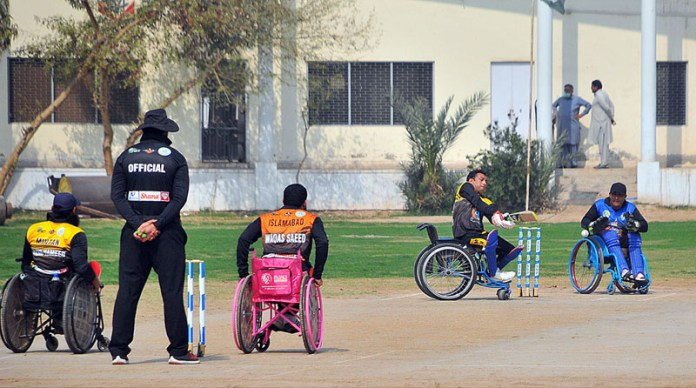 A view of disable person's cricket match playing between Multan and Islamabad teams during National Special Sports Festival 2021 organized by Society for Special Persons at Multan Cricket Ground