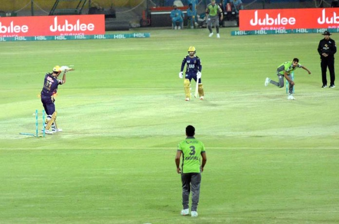 Quetta Gladiators' Ben Cutting is clean bowled by Lahore Qalandars' Haris Rauf during the Pakistan Super League (PSL) T20 cricket match between Lahore Qalandars and Quetta Gladiators at the National Stadium