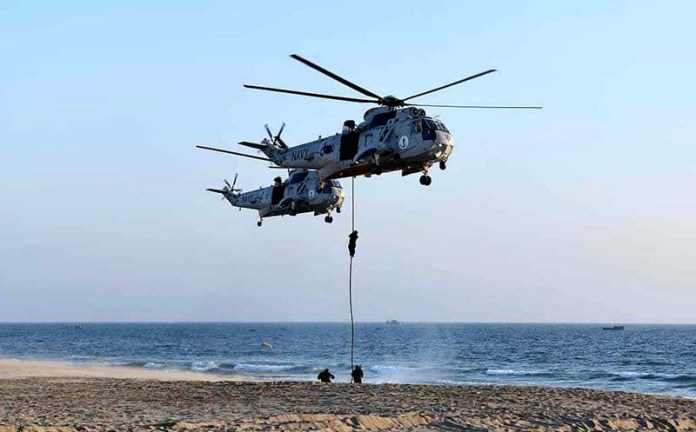 A view of Counter Terrorism Demo being presented by Special Service Group of Pakistan Navy during Multinational Maritime Exercise AMAN-21