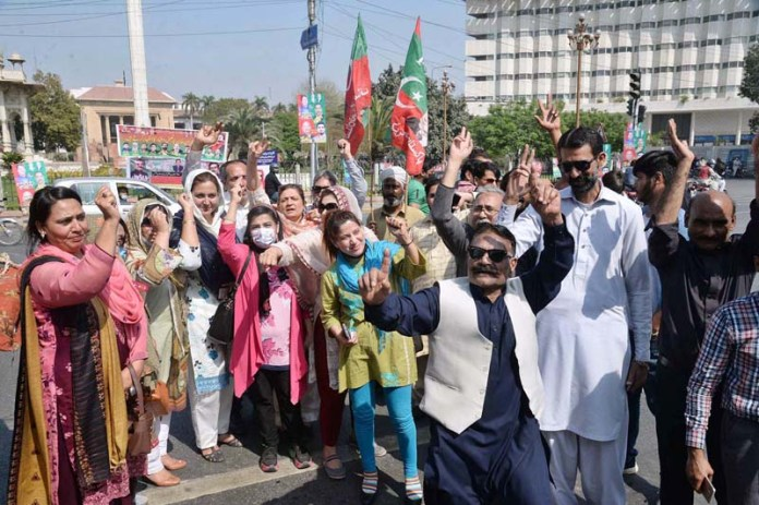 PTI workers celebrating at Mall Road after Prime Minister Imran Khan getting vote of confidence in Parliament House