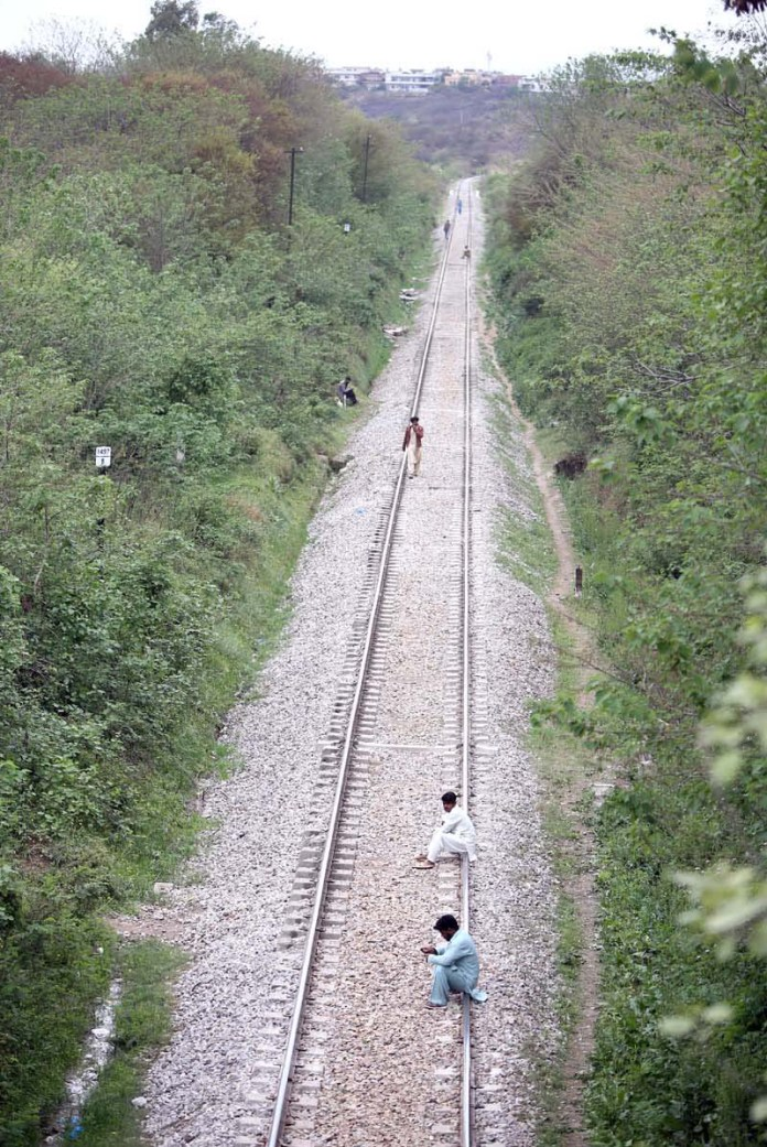 People sitting and walking on the rail tracks may cause any mishap and needs the attention of concerned authorities