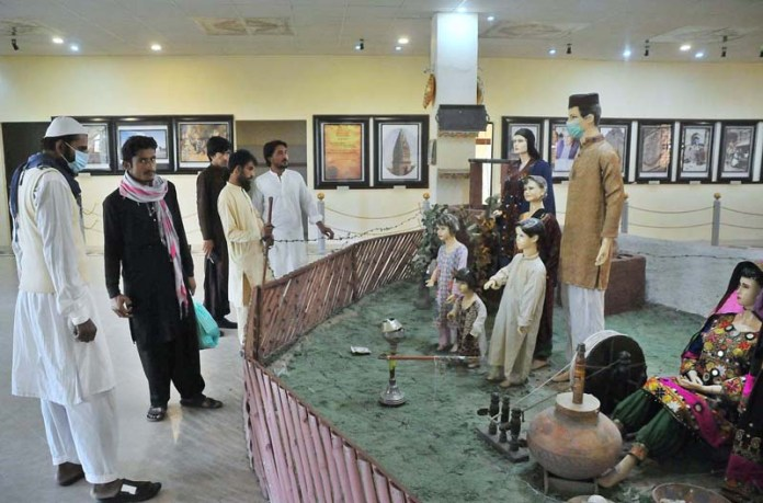Visitors viewing cultural models at Art Gallery Damdama