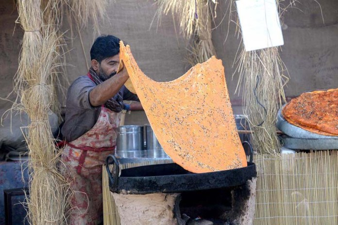 "A vendor busy in preparing traditional food item ""Katlama"" at Jilani Park during Jashan Biharan Mela"