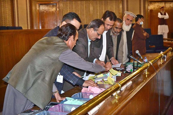 Election Commission's staffers counting votes in Balochistan Assembly during processes of senate election