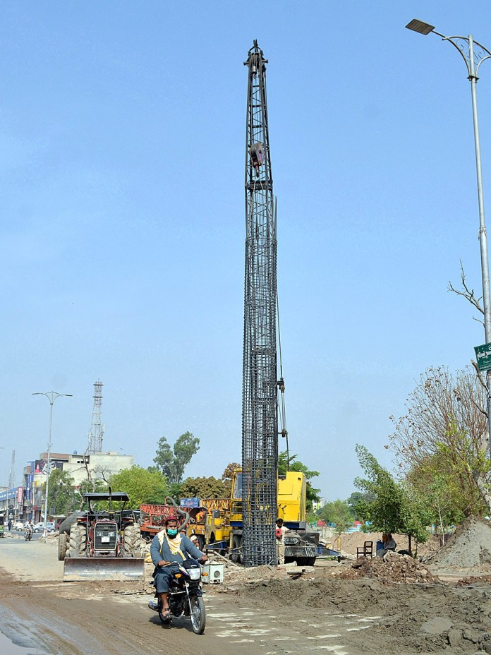 A view of construction work of flyover at Gulshan Market during development work in the city