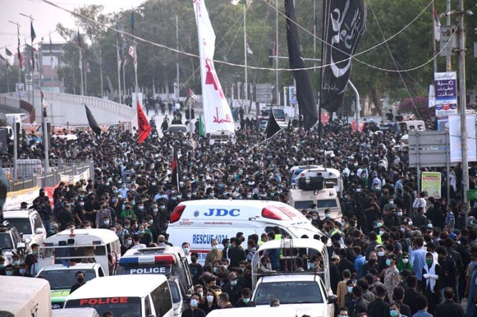 Devotees of Hazrat Ali Al-Murtaza (A.S) are holding mourning procession on the occasion of Youm-e-Ali (A.S), the day of martyrdom 21st Ramadan- ul-Mubarak, pass through at MA Jinnah Road