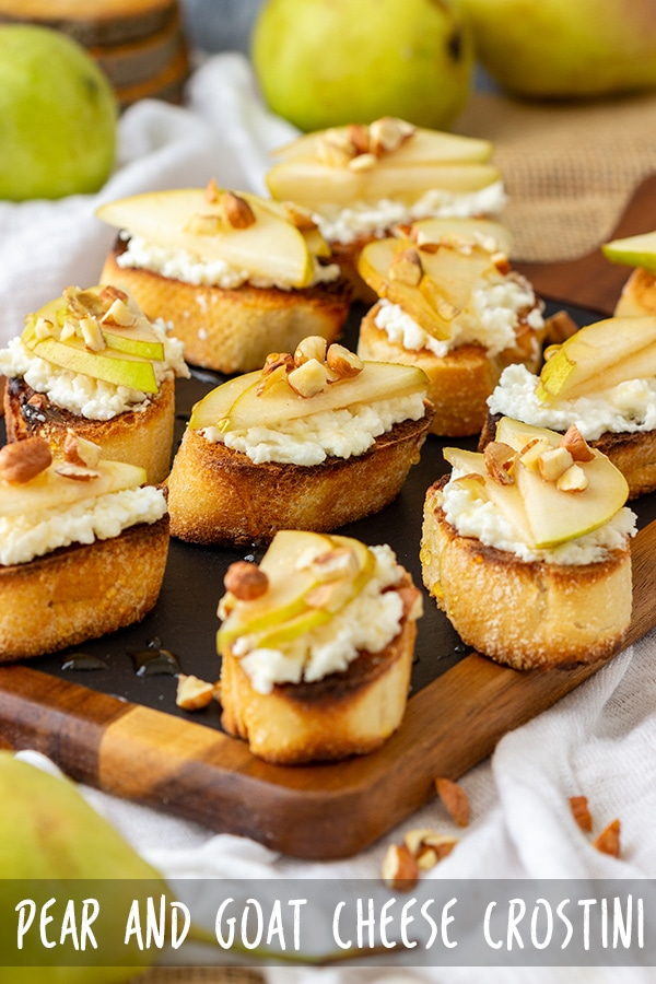 Pear and goat cheese crostini are an easy appetizer ready in 20 minutes! Crispy bread is topped with cheese layer, slices of pear, crushed nuts & drizzled with honey. #appetizeraddiction #pear #goatcheese #crostini #appetizer #recipe #partyfood #fingerfood