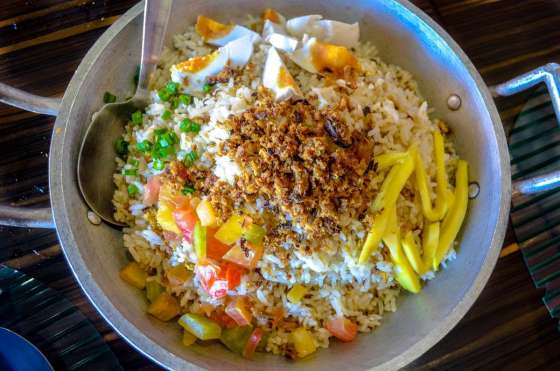 Tinapa Fried Rice Php255 Perfect blend of steaming fried rice and crispy tinapa flakes, infused with the piquant taste of salted egg slices, sweet fresh tomatoes, and the quaint sourness of green mangoes.