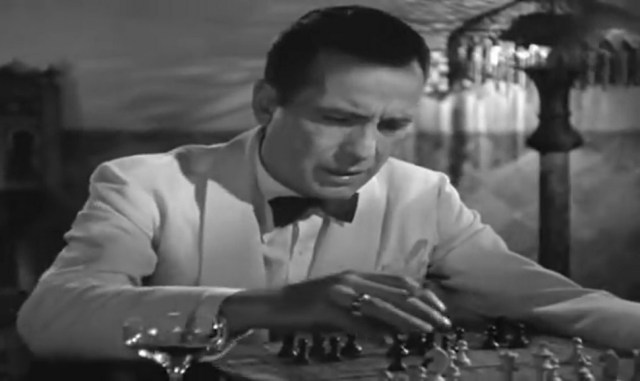 Rick looks over a chess position in the classic movie Casablanca