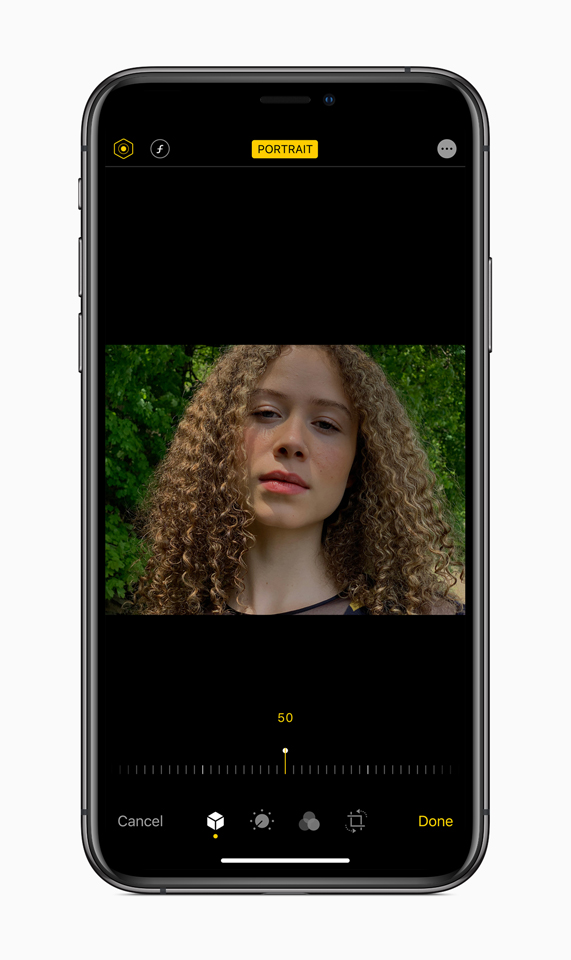 An image of a young woman showcasing Portrait Lighting adjustments in iOS 13.