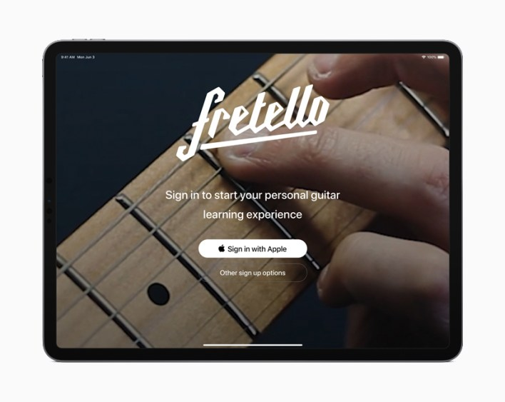 The login screen in iPadOS displaying Sign In with Apple option.
