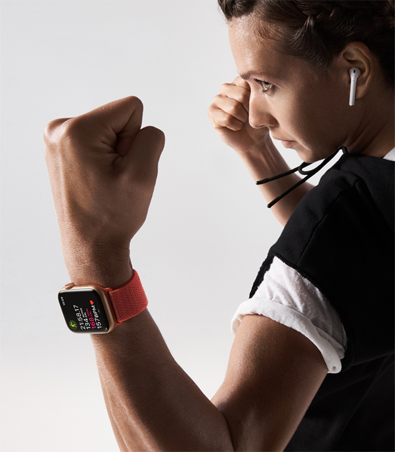 A woman wearing Apple Watch Series 4 while standing in fighter stance.