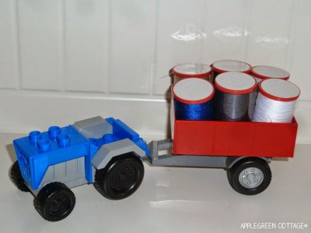 creative play, sewing thread spools as haystack