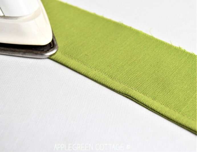 iron and green fabric with finished seam