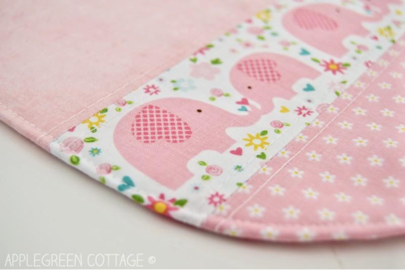 pink baby bib pattern detail