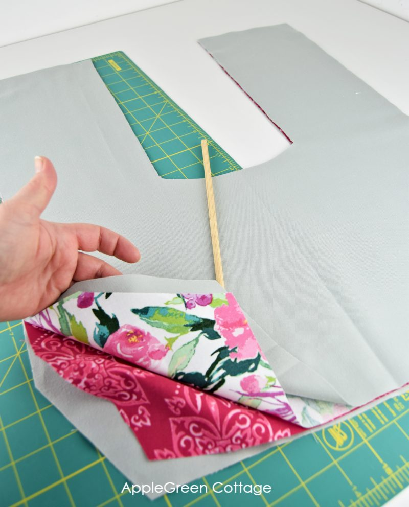 stacking pieces of fabric to sew a heating pad for back