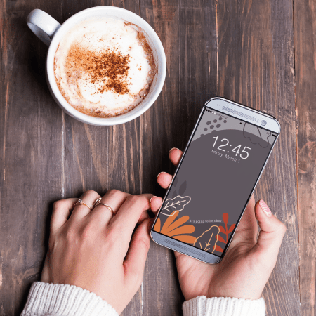 A October phone screen on a girl's phone drinking coffee