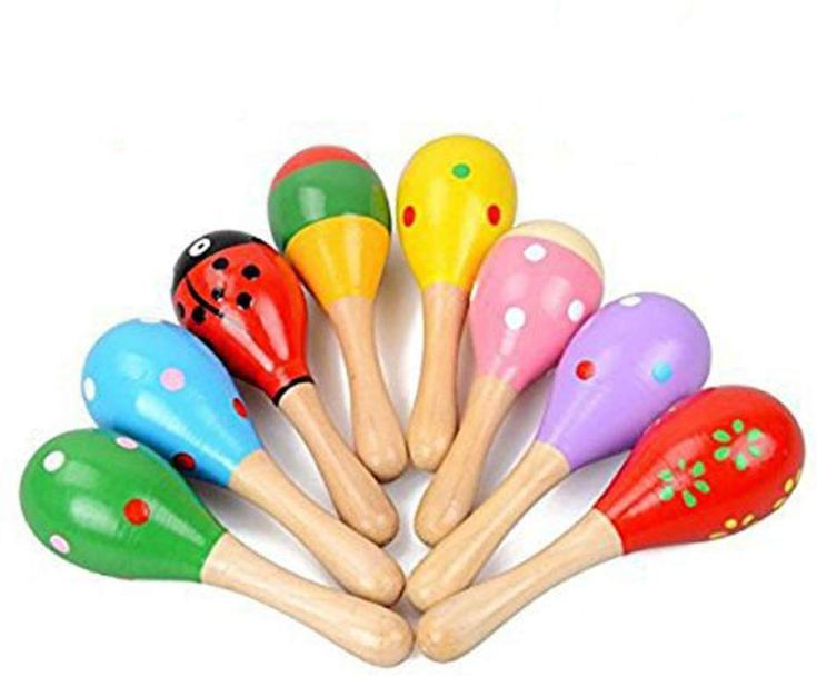 Holiday Gift Guide for Babies 6 and 7 months old. The perfect gits for babies 24-32 weeks old. Simple small maracas for babies. Easy to hold and shake!