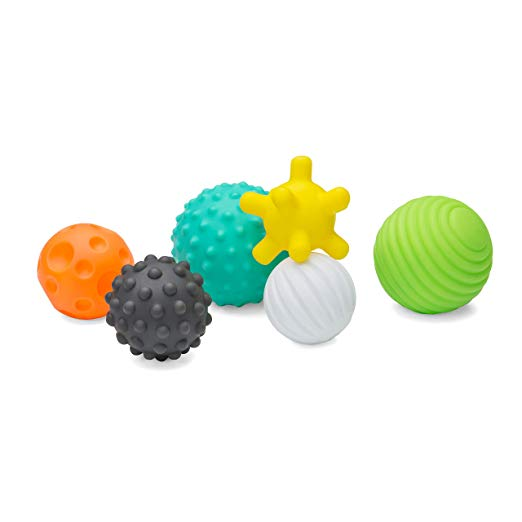 Holiday gift guide for babies 4 and 5 months old. The perfect holiday gift for babies 12 to 20 weeks old. Textured and different sizes to improve grip and sensory.