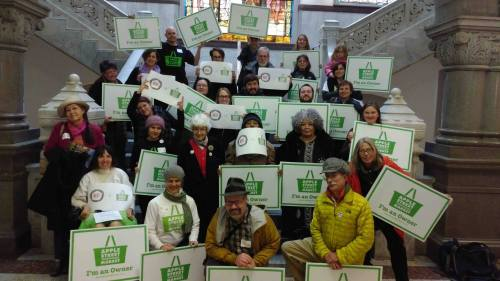 Lots of Apple Street Market & NEST supporters after November's Neighborhood's Committee meeting - standing on the marble steps outside of Council Chambers holding NEST & ASM signs.