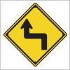 左への背向屈曲を表す道路標識