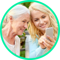 Young girl showing phone to older woman