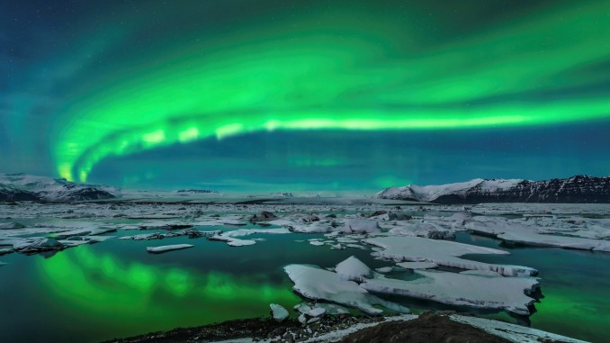 Spectacular aurora display over Jökulsárlón, Iceland