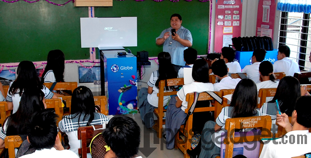 Global Filipino Teacher Emerson Dalangin demonstrates to students of Sico 1.0 National High School in San Juan, Batangas the effective way of using ICT tools donated by Globe Prepaid