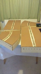 four boards painted brown to the rail line