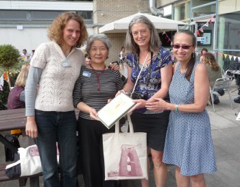 Nel, Miriam and April presented a gift portfolio to Keiko. (it was hard to organize everyone!)