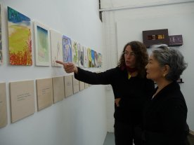 Eva and Keiko view the exhibition for the first time
