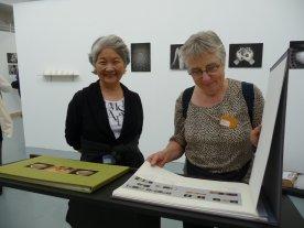 Keiko and Inger Lise enjoy Anita's book work