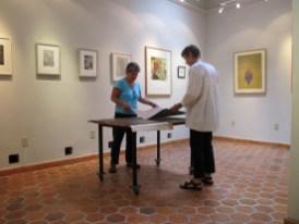 Debra and Liz look at his portfolio