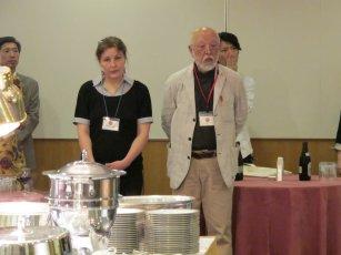after a long day of preparations, Tuula Moilanen listens with Akira Kurosaki
