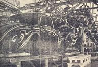 As carroçarias prontas, suspensas, para serem montadas aos chassis.