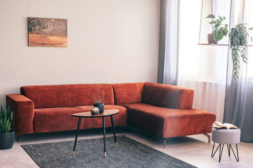 Red/Orange Suede couch in a bright