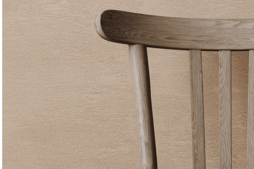 Close-up of Vintage Wood Chair in front of Tan Background