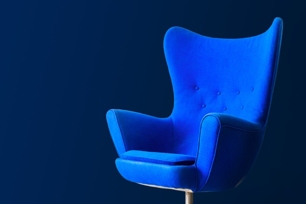 Royal Blue Egg Chair on Navy Background