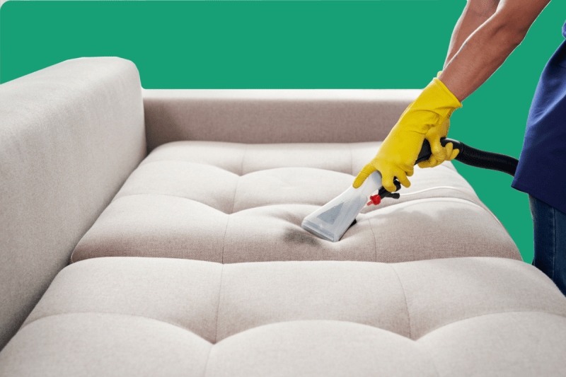 Cleaning sofa with vaccuum