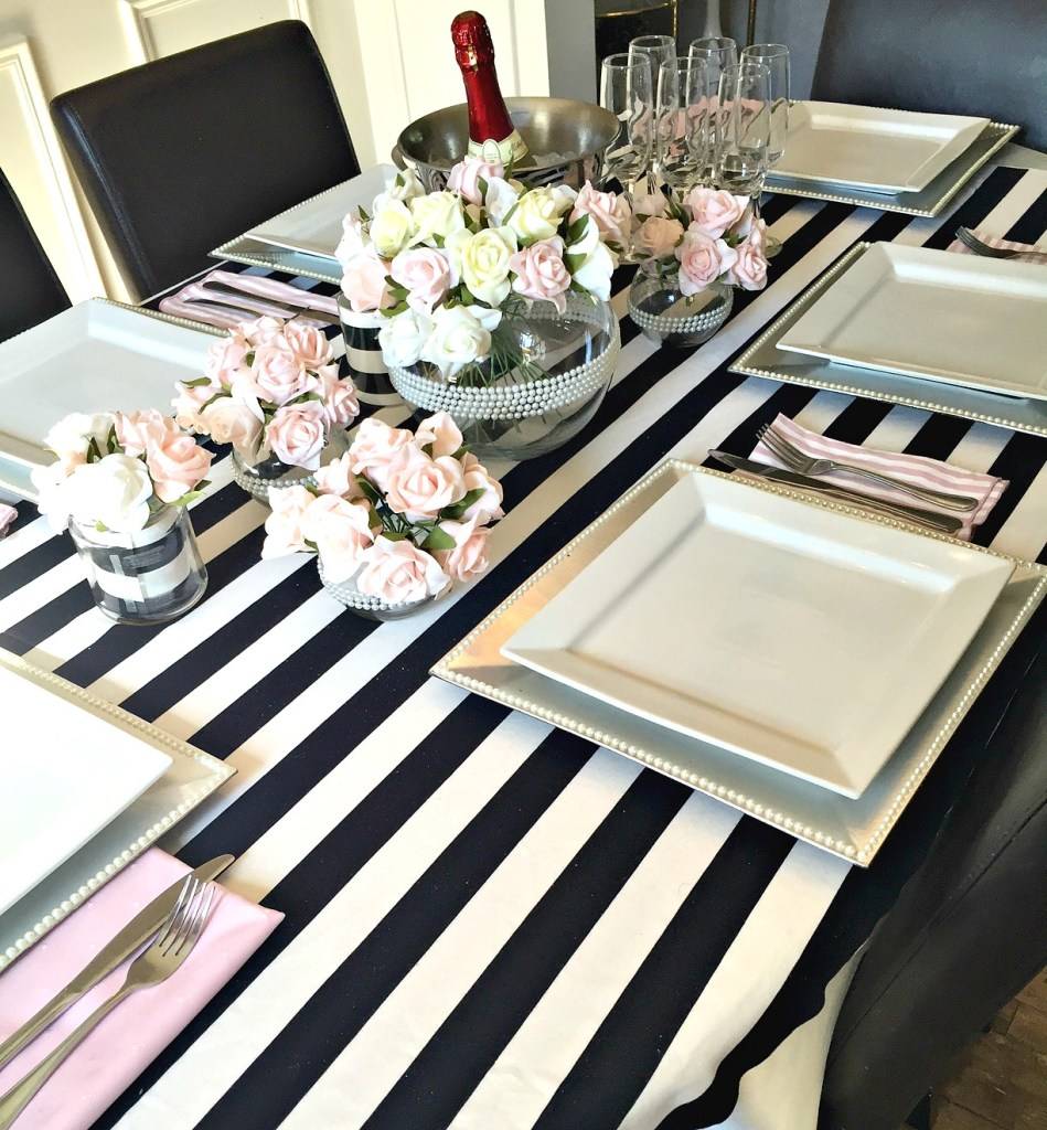How to set a pretty graduation tablescape, which can also be used for a wedding, bridal shower, or birthday party using black and white with pink roses at apurdylittlehouse.com