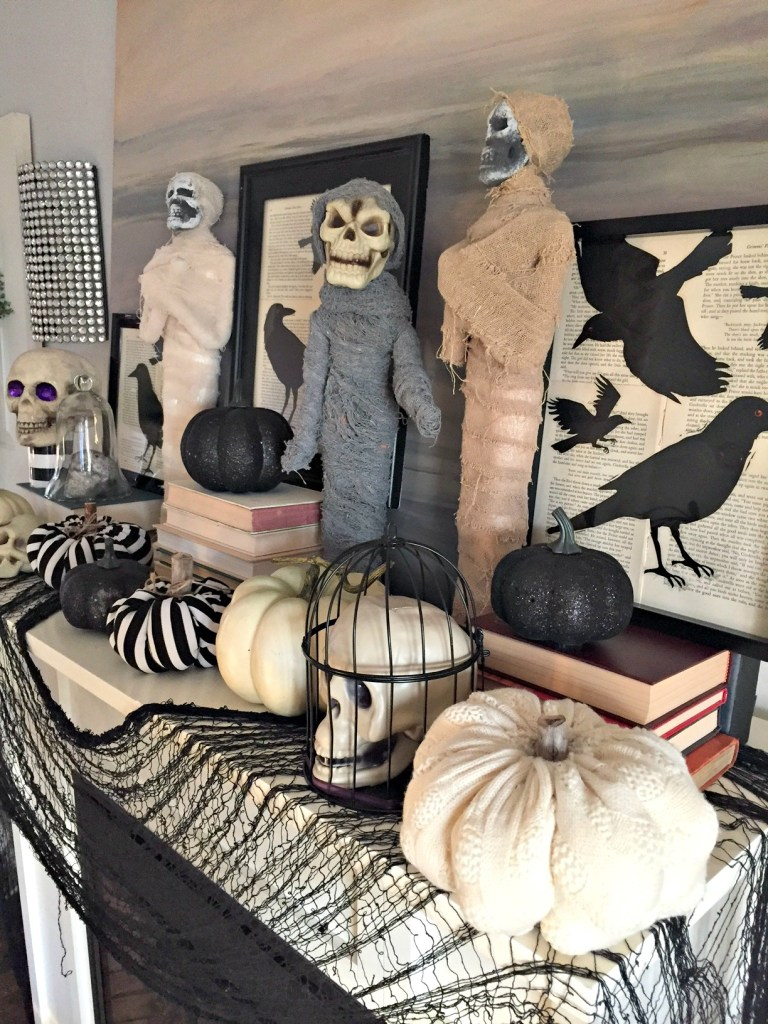 Halloween Mantel with mummys, pumpkins and ravens. See all the details at apurdylittlehouse.com